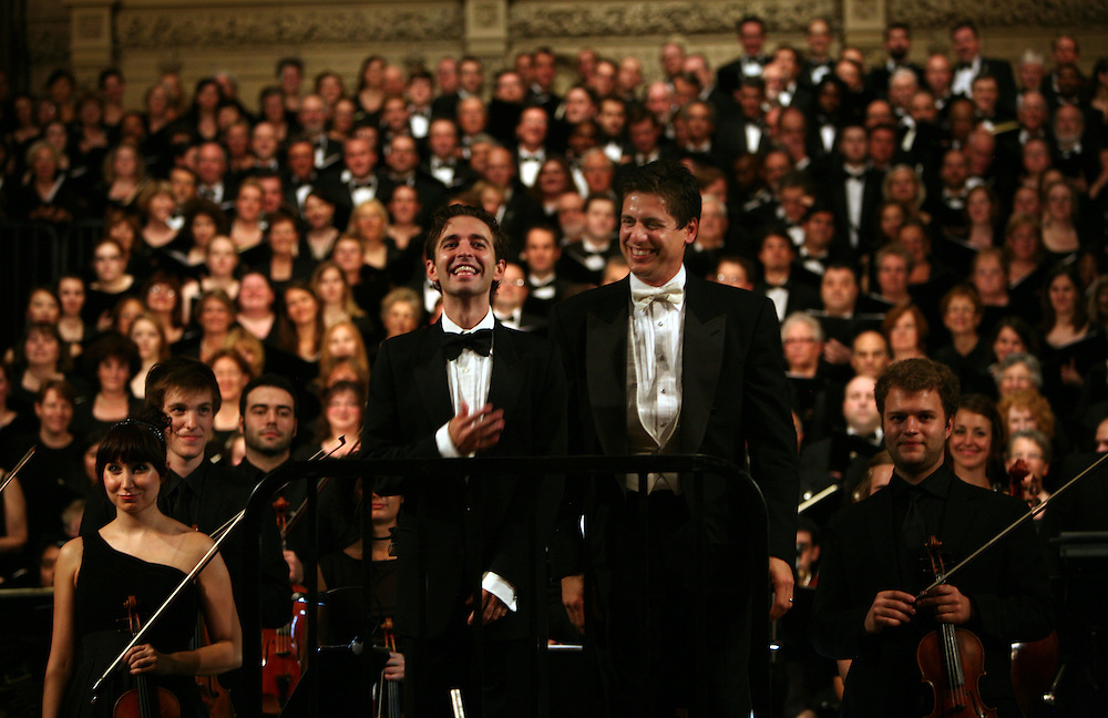 Countertenor Anthony Roth Costanzo, left, with conductor Francisco J. Nunez, right, during Remember to Love: Let Us Love One Another With A Sincere Heart, an observation of the 10th Anniversary of September 11 at Trinity Church in Manhattan, NY on September 09, 2011. The six choirs performing include NYC Master Chorale, Trinity Choir, Young People's Chorus of New York City, The Washington Chorus, The Bach Choir of Bethlehem and The Copley Singers.