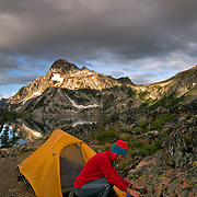 ID00379-00...IDAHO - Preparing breakfast at Sawtooth Lake backcountry campsite in the Sawtooth Wilderness area.