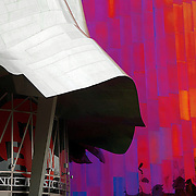 "SHOT 1/21/11 4:58:37 PM - Detail of some of the interesting architecture at the Experience Music Project and Science Fiction Museum and Hall of Fame (abbreviation rendered with a pipe as EMP|SFM). It is a museum dedicated to the history and exploration of both popular music and science fiction located in Seattle, Washington. The Frank Gehry-designed museum building is located on the campus of the Seattle Center, adjacent to the Space Needle and the Seattle Center Monorail, which runs through the building. Experience Music Project (EMP) was founded by Microsoft co-founder Paul Allen, and opened its doors in 2000. Seattle is the northernmost major city in the contiguous United States, and the largest city in the Pacific Northwest and in the state of Washington. A seaport situated on a narrow isthmus between Puget Sound (an arm of the Pacific Ocean) and Lake Washington, about 100 miles (160 km) south of the Canada - United States border, it is named after Chief Sealth ""Seattle"", of the Duwamish and Suquamish native tribes. Seattle is the center of the Seattle-Tacoma-Bellevue metropolitan statistical area, the 15th largest in the United States, and the largest in the northwestern United States. Seattle is the county seat of King County and is the major economic, cultural and educational center in the region. (Photo by Marc Piscotty / © 2011)"
