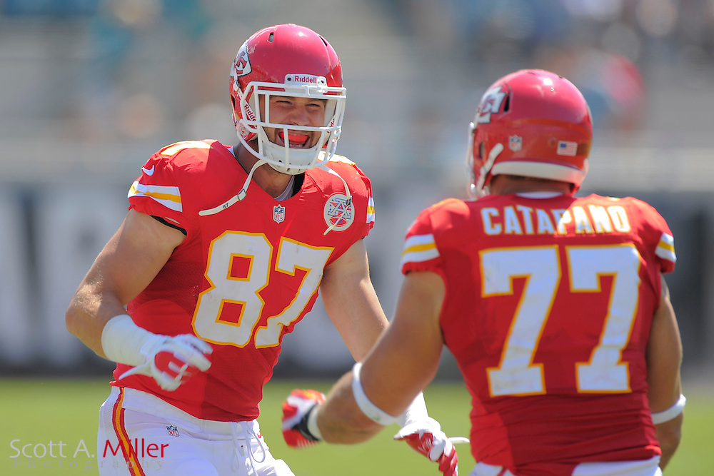 Kansas City Chiefs tight end Travis Kelce (87) and Kansas City Chiefs defensive end Mike Catapano (77) celebrate during the Chiefs 28-2 win over the Jacksonville Jaguars at EverBank Field on Sept. 8, 2013 in Jacksonville, Florida. The <br /> <br /> &copy;2013 Scott A. Miller