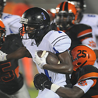 New Hanover High School's Issac Simmons tackles Wilson Hunt's Darrion Ballard Friday September 5, 2014 in Wilmington, N.C. (Jason A. Frizzelle)