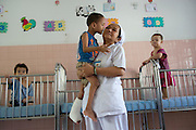 Nurse Hoang Thi Sinh says the children call her grandmother at the Peace Village within the Tu Du (Freedom) Obstetrics and Gynaecology Hospital in Ho Chi Minh City, Vietnam