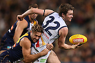 PERTH, AUSTRALIA - JULY 11: Patrick Dangerfield of the Crows looks to handball while being tackled by Mark Hutchings of the Eagles during the round 15 AFL match between the West Coast Eagles and the Adelaide Crows at Domain Stadium on July 11, 2015 in Perth, Australia.  (Photo by Paul Kane/Getty Images)