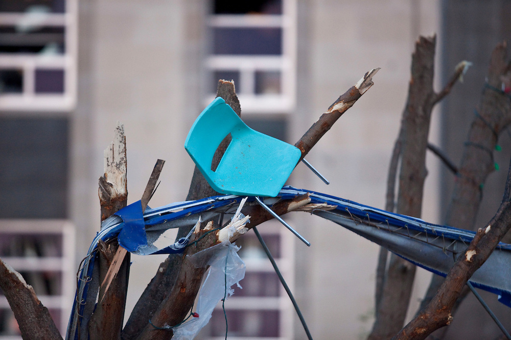 A chair from a building nearly a block away is wedged in a tree after a Tornado caused significant damage to the downtown core of Goderich Ontario, Sunday, August 21, 2011.<br /> THE CANADIAN PRESS/ Geoff Robins