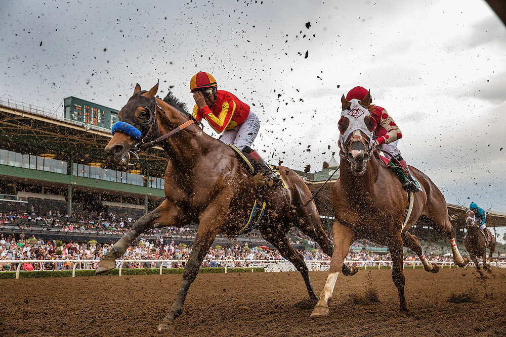 June 27 2015: Jockey Martin Garcia pulls down a fresh pair of goggles as he and Hoppertunity battle through the kickback in the Santa Anita Gold Cup at Santa Anita Park in Arcadia CA. Alex Evers/ESW/CSM
