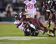 Ole Miss' Collins Moore (16) is tackled by Mississippi State defensive back Darius Slay (47) in Starkville, Miss. on Saturday, November 26, 2011.