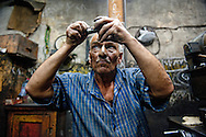 Workers manufacture parts for elevators in a small basement business in downtown Cairo, on September 22, 2011. Several labor groups have gone on strike in the past few weeks from transportation workers to teachers. Ann Hermes/© The Christian Science Monitor 2011