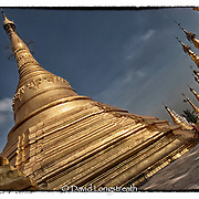 """In this """"Signature Series"""" image by David Longstreath, devotees and the faithful gather at the Swedagon pagoda in Rangoon, Burma. The Swedagon is Burma's most holy sight and is visited by thousand of Burmese each day."""