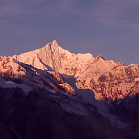 """MEILI MOUNTAIN, DECEMBER 17, 2000: a view of Mt. Meili in the morning in deqin county, Yunnan province , December 17, 2000..Mt. Meili is the highest peak in Yunnan province and according to supporters from Deqin county, it's a """"proof"""" that the 'real"""" Shangri-La is located in deqin county. The fictuous Mt. Karakal which is described in James Hilton's Lost Horizon, alledgedly is modelled on Mt. Meili in Yunnan province.."""