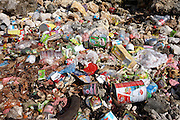 Household refuse pollutes a coral beach on Meedu Island, an indigenous community in the Republic of the Maldives in the Indian Ocean. Packaging, foodstuffs and general waste has been tossed away on this otherwise beautiful place, north of the capital Male. Unfortunately, the practice of tossing away one's rubbish is a normal practice in this culture, the local people selfishly unconcerned about the future of their habitat and the health of their community. Only a few miles from Meedu are islands that serve as holiday resorts where families from Europe travel by air for the perffect vacation - unaware that fly-tipping is so widespread that it threatens this nation's worldwide status as a paradise on earth..