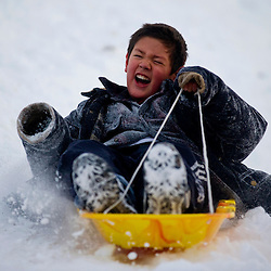 022210       Brian Leddy.Gabriel Duckett speeds down a sledding hill near Phillipina Avenue in Gallup on Monday. The storm that rolled through town early in the day cancelled school for many students.