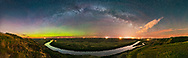 The &ldquo;river of stars&rdquo; &ndash; the Milky Way &ndash;&nbsp;arching over the scenic bend of the Red Deer River, Alberta, from the Orkney Viewpoint overlooking the Badlands and river valley, in a 270&deg; panorama. To the north at left, a weak aurora shines along the horizon. Bands of airglow also colour the sky to the east at centre, and perpetual twilight lights the sky at far left. <br /> <br /> To the south at right, the Milky Way becomes lost amid the light pollution from Drumheller, Alberta, made more obvious by some clouds drifting through. <br /> <br /> So this is a study in skyglows: aurora, twilight, airglow, Milky Way and urban skyglow, and of the contrast between the natural sky and light polluted sky. <br /> <br /> And of course, I like the way the curve of the Milky Way is mirrored in the curve of the river, which is why I picked this spot and this night in spring, when the Milky Way is still arching across the east and not overhead as it is later in summer. <br /> <br /> The most prominent stars reflected in the still waters of the rive are the stars of Delphinus the Dolphin, but there are no dolphins in this river! Only ones made of stars. <br /> <br /> This is a stitch of 8 segments with the Sigma 20mm Art lens, in portrait mode, and Nikon D750. Each 30 seconds at f/2 and ISO 3200. Stitched with Adobe Camera Raw. Taken on a mild and moonless night, May 20, 2017.