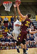Rochester Century guard Jamal Brown (24), left, tips away a layup by Northfield forward Zach Lant (33) during the first half of the high school basketball game between Northfield and Rochester Century, Tuesday, December 10, 2013.