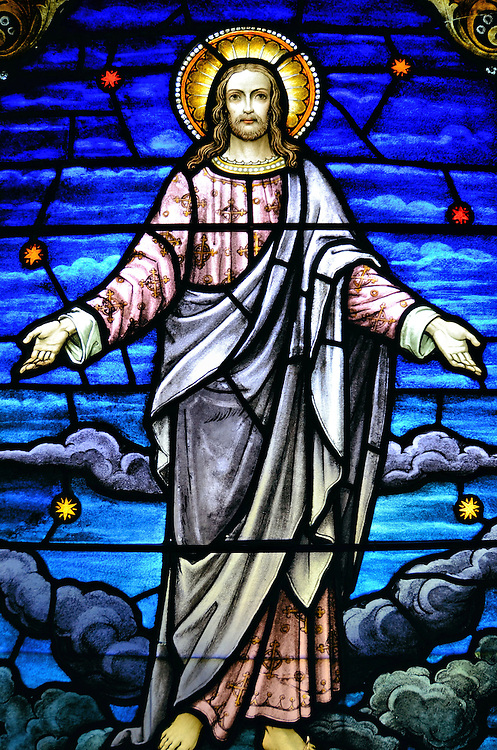 Ascension of Christ Stained Glass Window in Kīlauea on Kaua&rsquo;i, Hawaii <br /> The Christ Memorial Episcopal Church in Kīlauea was founded in 1888 by an English bishop but it wasn&rsquo;t until 1941 that a small, lava stone church was consecrated.  Surrounding it is a graveyard with parishioners who died since the late 19th century.  Inside are ten exquisite stained glass windows with images of Christ&rsquo;s life from birth until this one of the ascension. They were crafted in England in 1935.