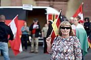 Frankfurt am Main   21 Apr 2015<br /> <br /> Am Dienstag (21.04.2015) hielt die rassistische und islamfeindliche Gruppe PEGIDA (Patriotische Europ&auml;er gegen die Islamisierung des Abendlandes) an der Hauotwache neben der Katharinenkirche in Frankfurt am Main eine Mahnwache unter dem Motto &quot;Wir sind wieder da&quot; ab. Die Kundgebung war wie immer mit Hamburger Gittern abgesperrt und von starken Polizeikr&auml;ften bewacht. Etwa 1000 Menschen nahmen an den Gegenprotesten teil.<br /> Hier: Eine PEGIDA-Aktivistin tr&auml;gt eine als Sonnenbrille getarnte Videokamera-Brille, vermutlich das Modell &quot;Rollei Bullet Sunglasses Cam 100 Full HD 63&deg;&quot;.<br /> <br /> &copy;peter-juelich.com<br /> <br /> [Foto Honorarpflichtig   No Model Release   No Property Release]