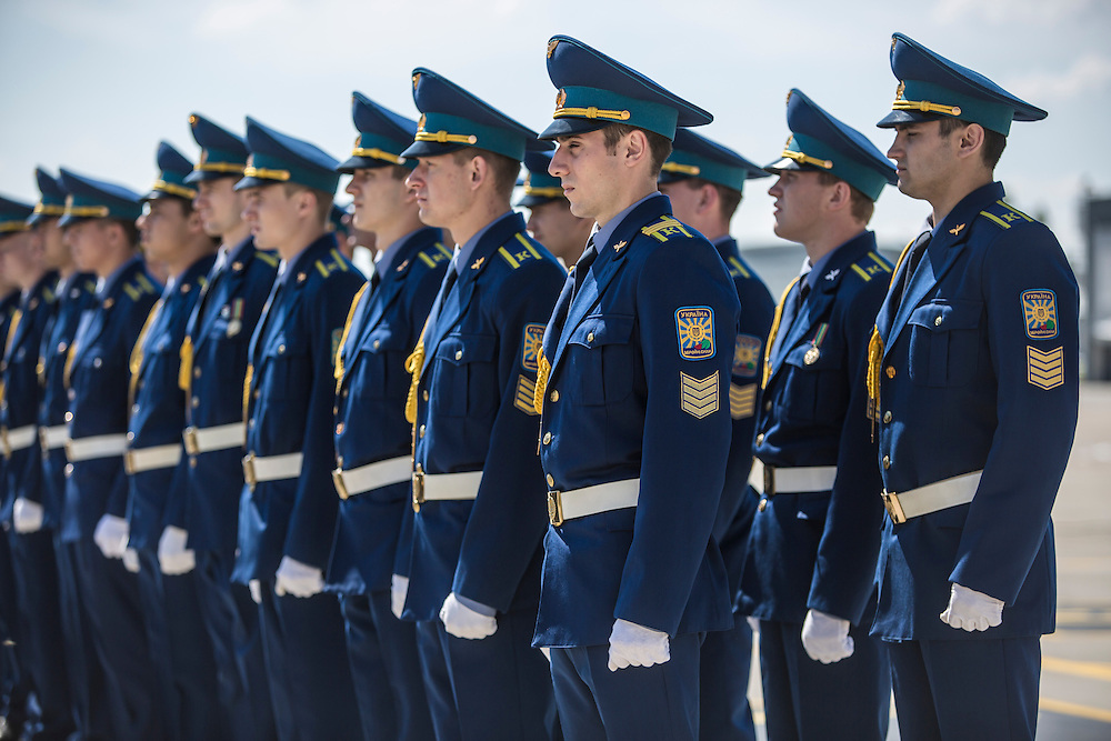 KHARKIV, UKRAINE - JULY 23: Members of the Ukrainian military stand at attention as coffins containing the bodies of victims of the crash of Malaysia Airlines flight MH17 are loaded onto a plane for transport to the Netherlands during a departure ceremony on July 23, 2014 in Kharkiv, Ukraine. Malaysia Airlines flight MH17 was travelling from Amsterdam to Kuala Lumpur when it crashed killing all 298 on board including 80 children. The aircraft was allegedly shot down by a missile and investigations continue over the perpetrators of the attack. (Photo by Brendan Hoffman/Getty Images) *** Local Caption ***