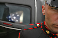 A Marine stands at attention in front of the hearst after a funeral service for Marine Lance Cpl. Michael L. Ford, at a cemetery in Onset, Mass., on Tuesday. Ford, 19, of New Bedford, Mass., was killed April 26 in Iraq when his tank hit a roadside bomb in Anbar province.