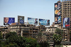Billboards for presidential candidates Ahmed Shafiq (left) and Amr Moussa (center) adorn Zamalek neighbourhood in Cairo.