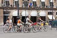 tourists on hired bikes in Place Vendôme Paris France in May 2008