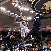 SOUTH BEND, IN - JANUARY 12: Garrick Sherman #11 of the Notre Dame Fighting Irish shoots the ball against DeAndre Daniels #2 of the Connecticut Huskies at Purcel Pavilion on January 12, 2012 in South Bend, Indiana. Connecticut defeated Notre Dame 65-58. (Photo by Michael Hickey/Getty Images) *** Local Caption *** Garrick Sherman; DeAndre Daniels