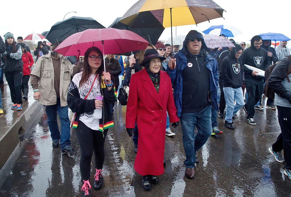 Dolores Huerta, center, the activist who started the National Farm Workers Association with Cesar Chavez, marches with family members, including Maya Tushka, front left, and Emilio Huerta, third from left, during the annual Cesar Chavez Day march, Saturday, April 1, 2017, in Albuquerque, N.M. (Marla Brose/Albuquerque Journal)