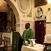 A priest conducts Sunday mass in the church of Santo Stefano di Sessanio, in the province of L'Aquila in Abruzzo.