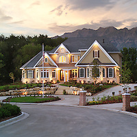 Evening shot of a newly built home in the River Bottoms of Provo that was the cover of the Home Show Magazine.