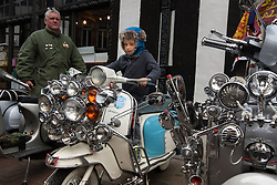 London, May 2nd 2015. Scores of scooter fanatics assemble in Carnaby Street for the annual Buckingham Palace Scooter Run that started life in the early eighties and was resurrected a few years ago by the New Untouchables and Bar Italia Scooter Club, with the run taking in many of the tourist hotspots in the capital before heading down the Mall towards Buckingham Palace. PICTURED:  Louie Howley, 3, from West Hampstead tries out a scooter for size.