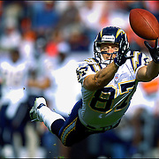 SHOT 9/26/2004 - The San Diego Chargers' Tim Dwight (#87, WR) dives for a deep pass from teammate Drew Brees during the first half of their game against the Denver Broncos at Invesco Field at Mile High Stadium. Dwight wasn't able to haul in the pass, it was just out of his reach. The Denver Broncos won the game 23-13.