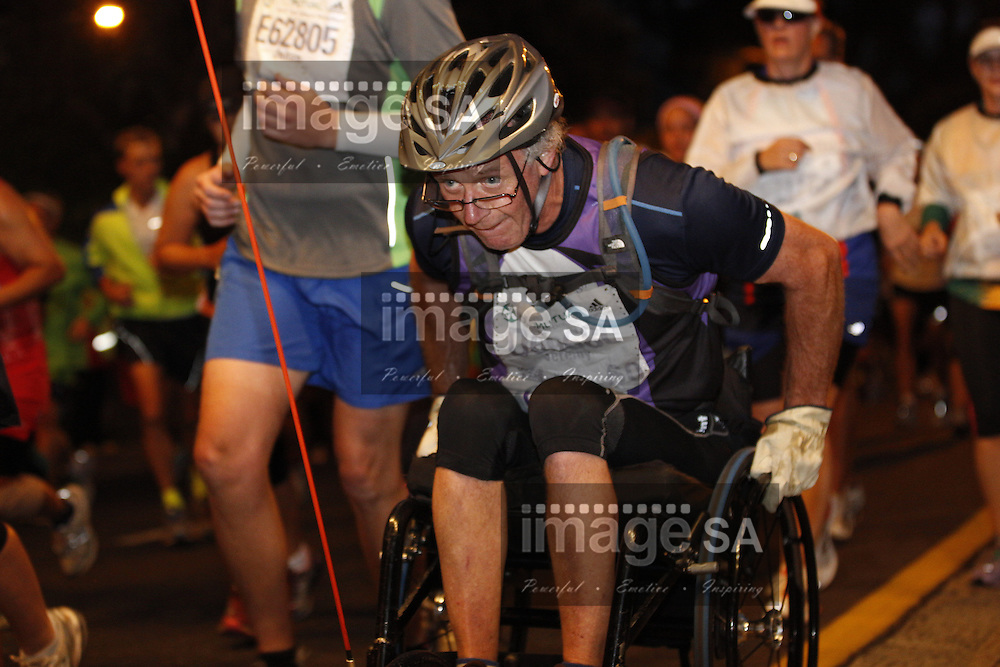 CAPE TOWN, South Africa - Saturday 30 March 2013, Wheelchair disabled contestant during the half marathon of the Old Mutual Two Oceans Marathon. .Photo by Nick Muzik/ ImageSA