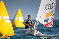 The Laser World Championships 2013 -  Standard. Mussanah Oman<br /> The final day of racing, Philipp Buhl (GER) shown here in action and celebrating after finishing 3rd overall<br /> Credit: Lloyd Images.