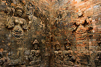 The sanctuaries inside the towers at Prasat Kravan are remarkable for the large bas relief depictions of Vishnu and Lakshmi that have been carved into the walls of red sandstone.
