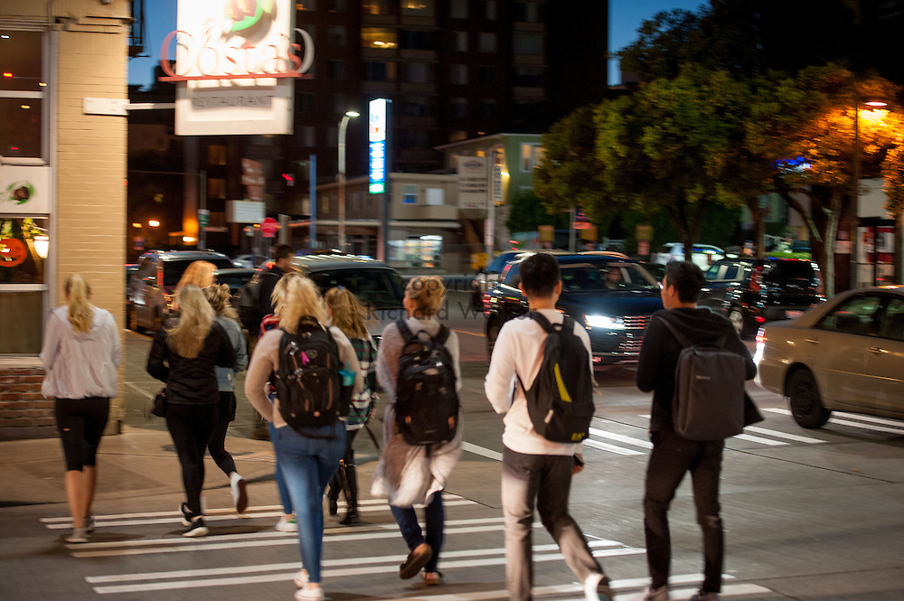 2016 October 10 - People cross the street in the University District, Seattle, WA, USA. By Richard Walker