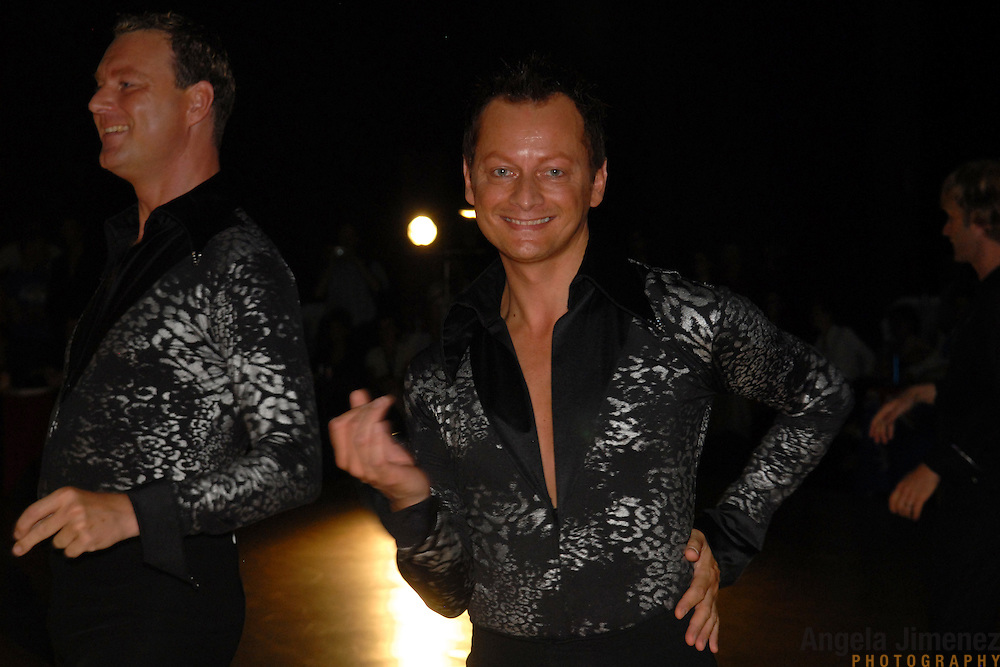 Eric Boog, left, and Gerard van Bodegom, both of Amsterdam, The Netherlands, compete in the men's latin division of the same-sex ballroom dancing competition during the 2007 Eurogames at the Waagnatie hangar in Antwerp, Belgium on July 13, 2007. ..Over 3,000 LGBT athletes competed in 11 sports, including same-sex dance, during the 11th annual European gay sporting event. Same-sex ballroom is a growing sports that has been happening in Europe for over two decades.