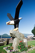 USA, Alaska, Inside Passage, Ketchikan, Eagle Park, Thundering Wings totem carving by Tlingit Artist Nathan Jackson, downtown Ketchikan in background