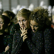 """Color guard captains Alaicia Kuyken, center, and Angela Jiskoot, right, show anxiety as they prepare to take the field in Marshall Mn., for the awards ceremony.  The MOC Floyd Valley band had not lost a competion in two years, but were stuggling with a difficult  program this year.  """"I dreaded standing on the field while they were calling out awards for the other bands,"""" said Kuyken.  """"I had never failed in band before,"""" said Jiskoot.  """"As a section leader, I felt like I hadn't pushed the other girls enough.  We just have to get better."""""""
