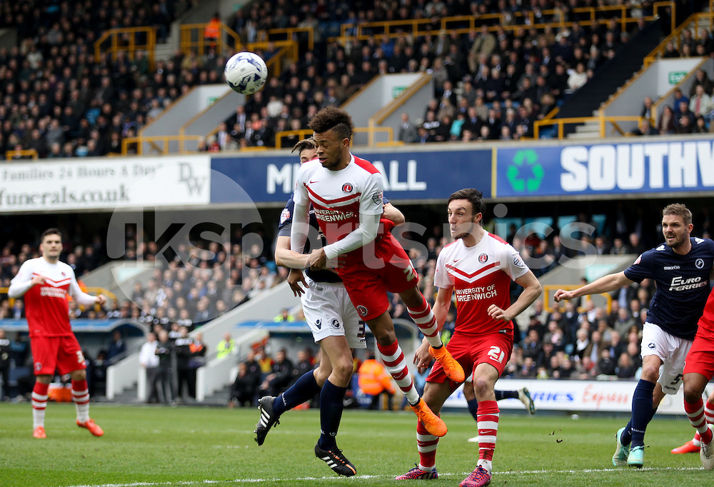 Jordan Cousins of Charlton Athletic heads clear during the Sky Bet Championship match between Millwall and Charlton Athletic at The Den, London, England on 3 April 2015. Photo by Edmund  Boyden.
