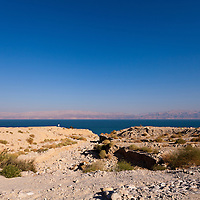 A flood-control spillway leading to a rocky beach on the western Dead Sea coast near Ein Gedi.