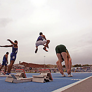 Runners prepare for a sprint race at the 2006 Drake Relays in Des Moines, Iowa.