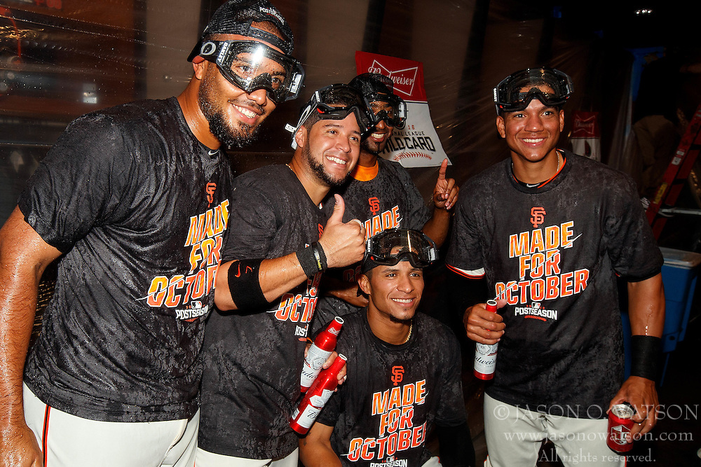 SAN FRANCISCO, CA - OCTOBER 02: The San Francisco Giants celebrate after the game against the Los Angeles Dodgers at AT&T Park on October 2, 2016 in San Francisco, California. The San Francisco Giants defeated the Los Angeles Dodgers 7-1. (Photo by Jason O. Watson/Getty Images) *** Local Caption ***