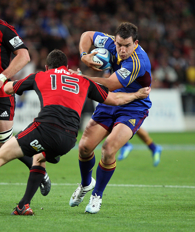 Highlander's John Hardie in the tackle of Crusader's Tom Marshall in the Super 15 rugby match at Forsyth Barr Stadium, Dunedin, New Zealand, Saturday, March 03, 2012. Credit:SNPA / Dianne Manson