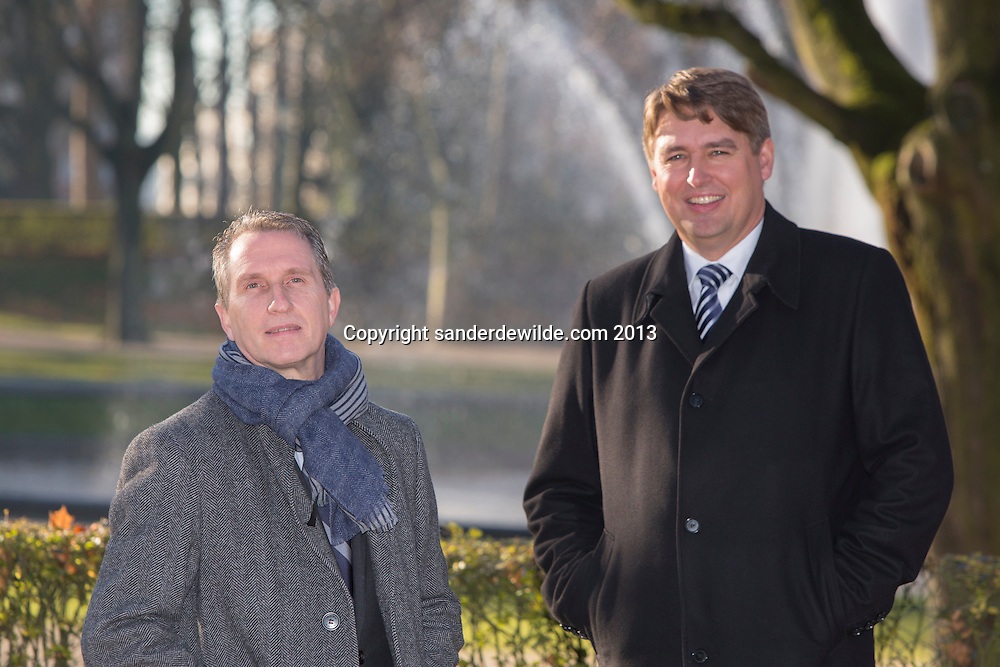 Andreas Gerland and Alain Seconde walk in the Jubelpark, in front of the  Jubel arch, near the European headquarters.
