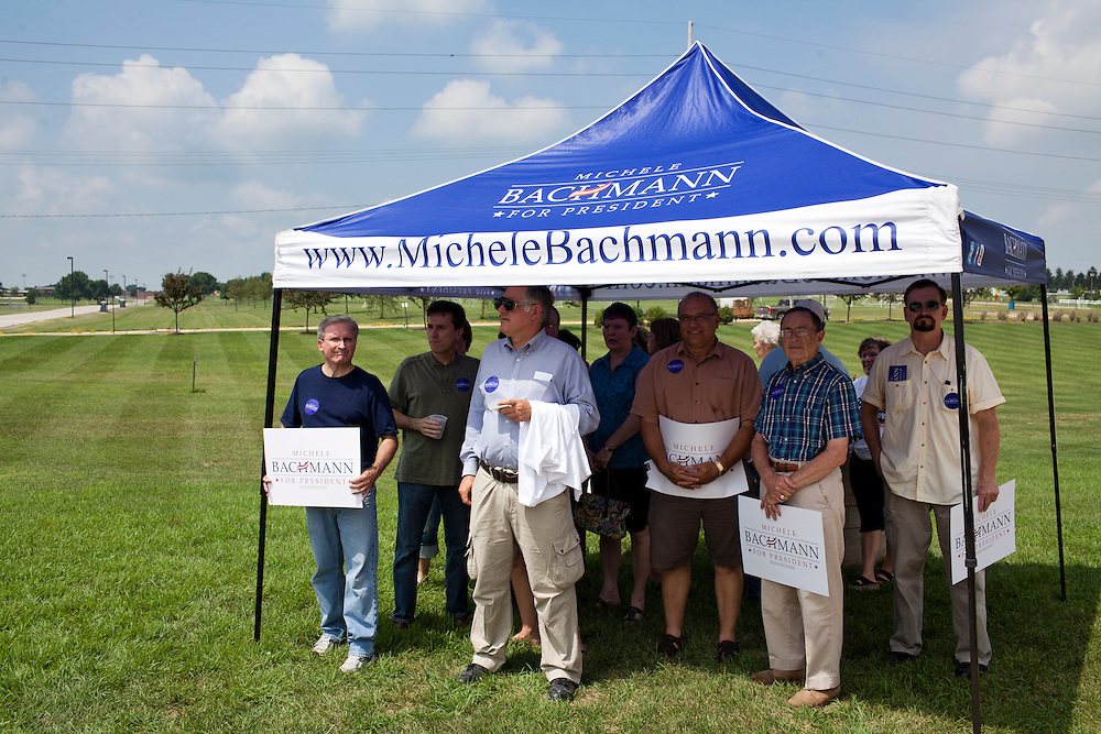 People wait in the shade for Republican presidential hopeful Michele Bachmann at a campaign stop on Saturday, August 6, 2011 in Cedar Rapids, IA.