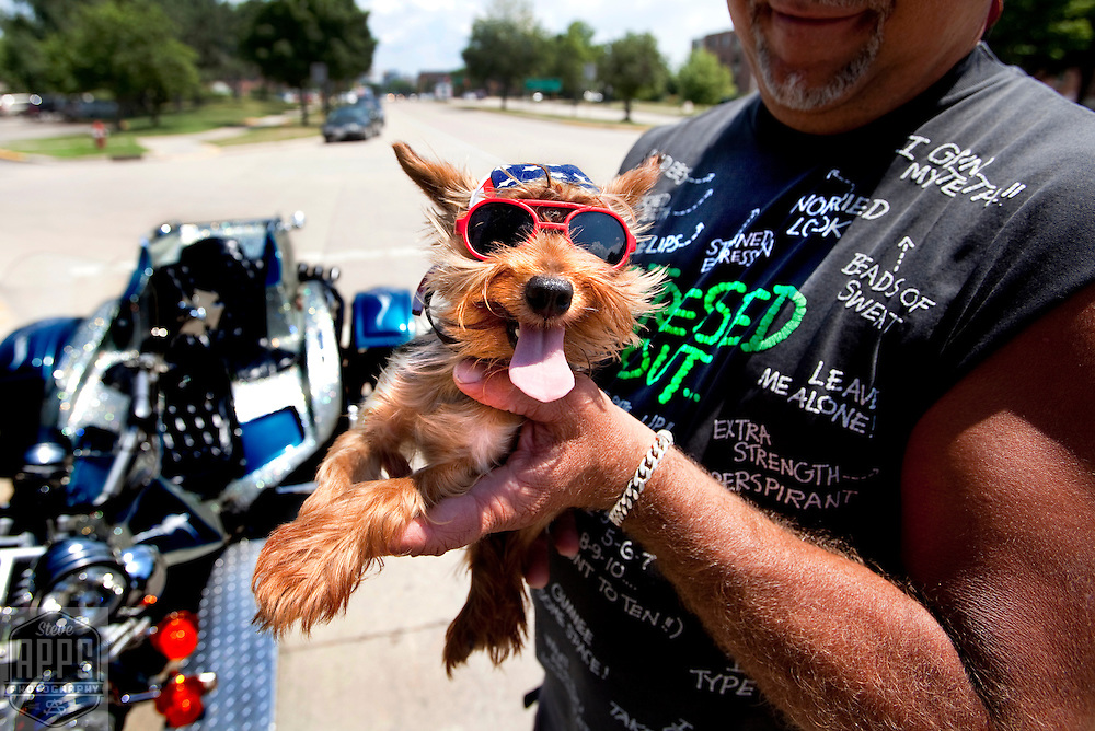 Dennis Treinen waits with Elvis, a 4-year-old Teacup Yorkie, Friday July 8, 2011,  along West Washington Ave. in Madison for ride to tow his broken down Custom Trike motorcycle back home. Treinen said that Elvis goes everywhere with him and ride in a harness on his chest. When not riding Elvis like to sit on his shoulder. Steve Apps-State Journal.