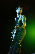 Dave Navarro of Jane's Addiction performing at the 2003 Gravity Games at the the North Coast Harbor behind the Rock and Roll Hall of Fame in Cleveland Ohio. Photo by Bryan Rinnert/3Sight Photography
