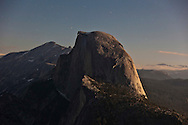 Half Dome illuminated by moonlight as seen from Glacier Point - Yosemite National Park, California