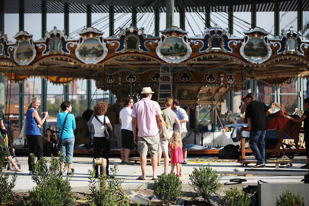 Friends of the Walentas' guide carousel horses from a studio to the Brooklyn Bridge Park on September 2.  Jane's Carousel is the work of Mrs. Walentas, who donated the piece to the park after years of restoring the carousel to its original splendor. ..CREDIT: Daniella Zalcman for The Wall Street Journal.SLUG: NYJANES