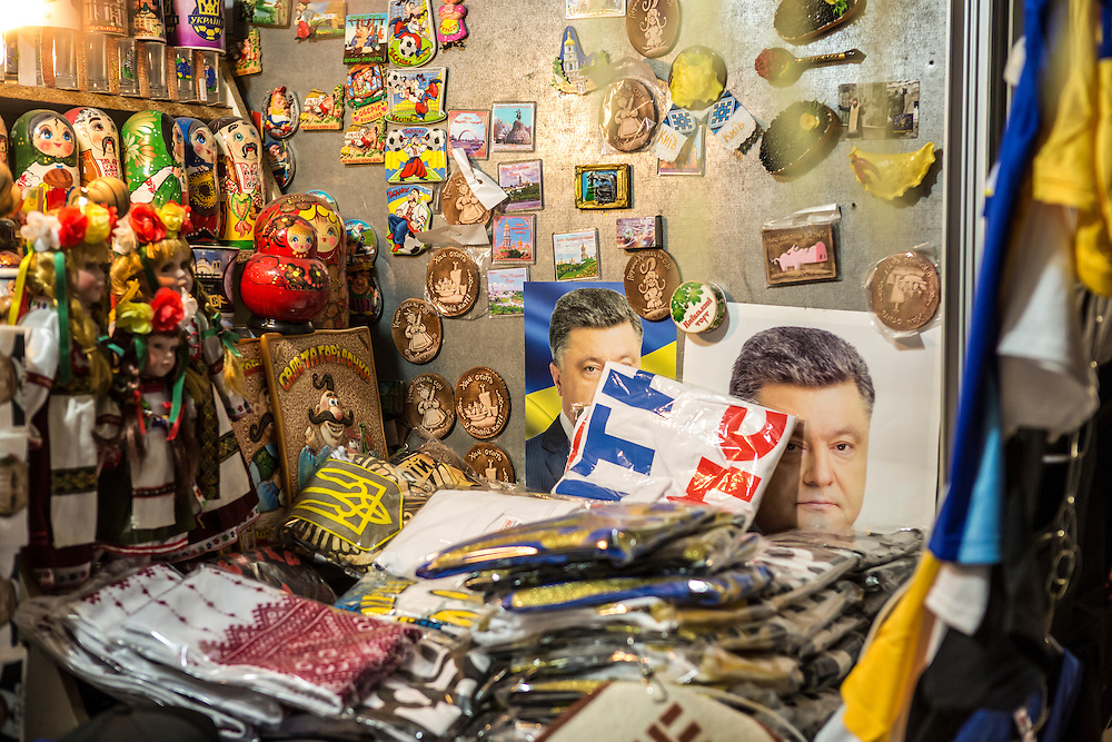KIEV, UKRAINE - OCTOBER 26: Pictures of President Petro Poroshenko are for sale among other tourist items in a shop on the day of nationwide parliamentary elections on October 26, 2014 in Kiev, Ukraine. Although a low turnout is expected in the east of the country amid continued fighting between Ukrainian forces and pro-Russian separatists, Ukraine is expected to elect a pro-Western parliament in a further move away from Russian influence. (Photo by Brendan Hoffman/Getty Images) *** Local Caption ***