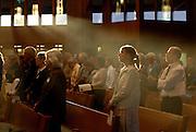 Sun shines through windows of a smoke-filled St. Bernard Church in Green Bay. (Sam Lucero photo)