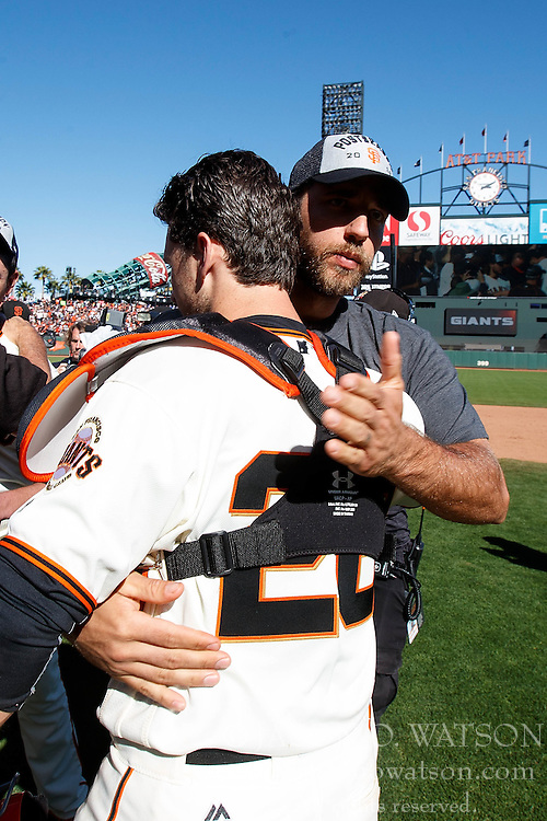 SAN FRANCISCO, CA - OCTOBER 02: Buster Posey #28 of the San Francisco Giants celebrates with Madison Bumgarner #40 after the game against the Los Angeles Dodgers at AT&T Park on October 2, 2016 in San Francisco, California. The San Francisco Giants defeated the Los Angeles Dodgers 7-1. (Photo by Jason O. Watson/Getty Images) *** Local Caption *** Buster Posey; Madison Bumgarner